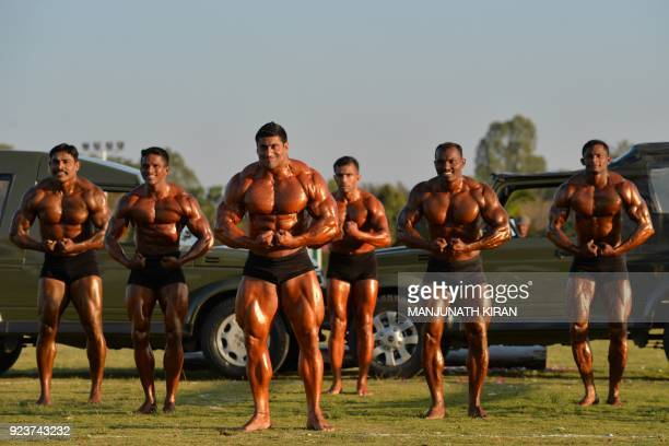 Indian army soldiers displaybody building skills at an event organised by the Indian Army's ASC Centre and College in Bangalore on February 24 2018...