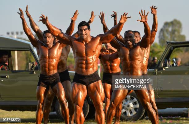 Indian army soldiers displaybody building skills at an event organised by the Indian Army's ASC Centre and College in Bangalore on February 24, 2018....