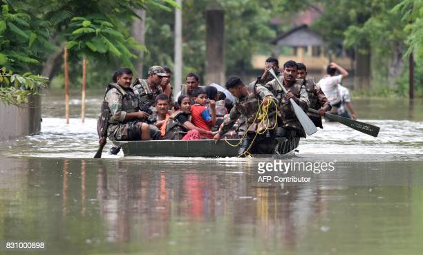 Indian army soldiers evacuate villagers in the flood affected Jakhalabandha area in Koliabor some 186km from Guwahati the capital city of Indias...