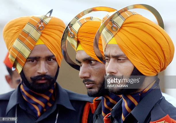 Indian army soldiers from a Sikh regiment listen to Indian Prime Minister Manmohan Singh's speech at the Red Fort as part of celebrations for India's...