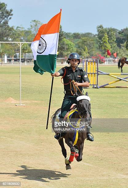 Indian Army soldiers from the Army Services Corps Centre and College rides a horse during a training and combat preparedness demonstration in...
