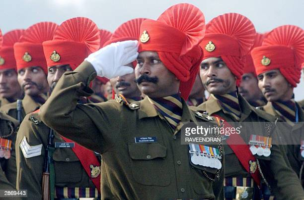 Indian army soldiers from the Rajputana Rifles regiment salute during the Army Day parade in New Delhi 15 January 2004 The Indian army celebrated the...