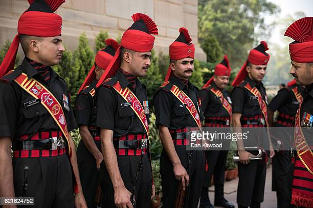 Indian Army soldiers gather at the India Gate War Memorial before British Prime Minister Theresa May layed a wreath on November 7 2016 in New Delhi...