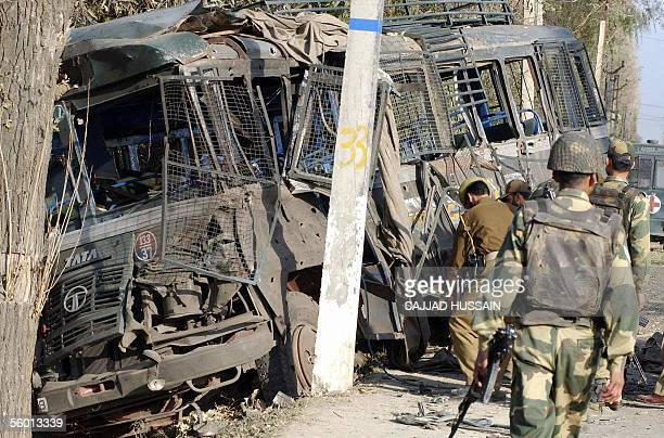 Indian army soldiers gather beside a damaged bus at Zainakote on the outskirts of Srinagar 26 October 2005 At least one border guard was killed and...