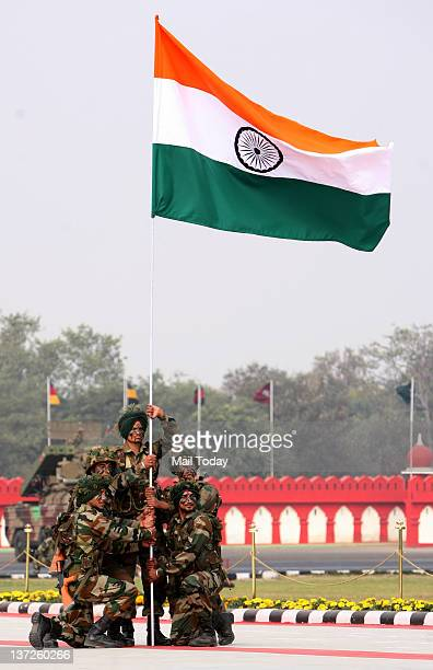 Indian army soldiers hold an Indian flag during the Indian Army Day in New Delhi India Sunday January 15 2012