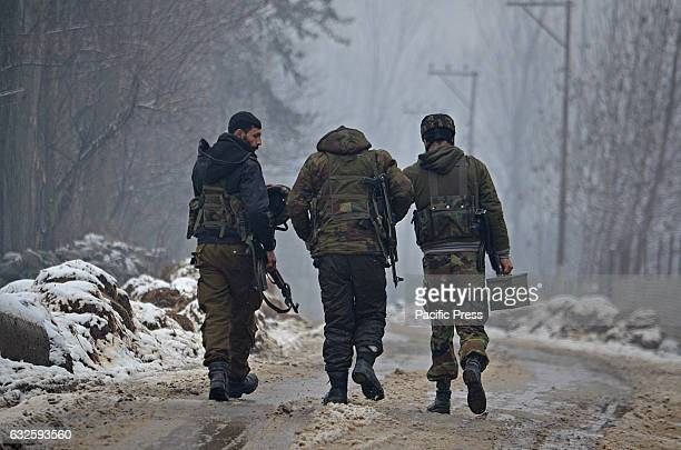 Indian army soldiers move towards the encounter site in Bakura area some 20 kilometers from Srinagar the summer capital of Indian controlled Kashmir...