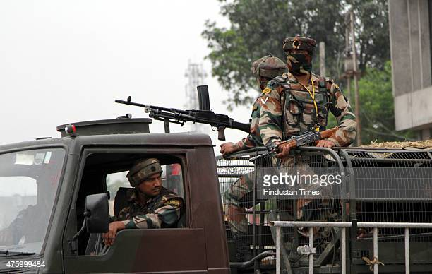 Indian Army soldiers on vehicles conduct a flag march during a curfew on June 5 2015 in Jammu India Indefinite Curfew was by the administration after...