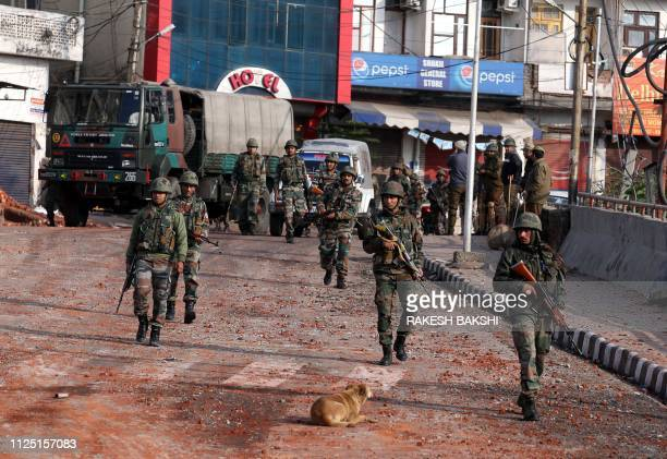 Indian army soldiers patrol during a curfew in Jammu on February 16 following a deadly attack on paramilitary troops near Srinagar in Jammu and...