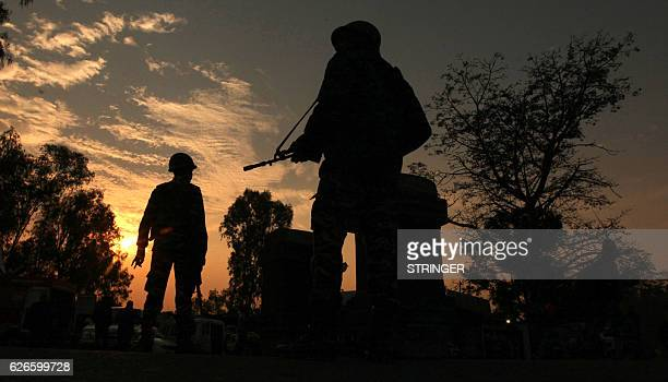 Indian army soldiers patrol on the JammuSrinigar National Highway during a combing operation after a gun battle with armed militants at an Indian...