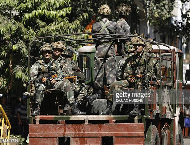 Indian Army soldiers patrol outside Nariman House the scene of one of a string of coordinated attacks in Mumbai on November 27 2008 Up to 100 people...