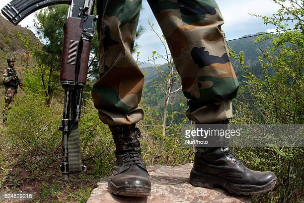 Indian army soldiers patrol the the Line Of Control on April 20 2015 in Gohalan 120 Kms north west of Srinagar the summer capital of Indian...