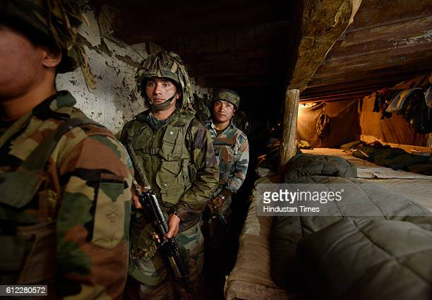 Indian Army soldiers prepare to move from the 'Ghatak Bunker' in a forward post at the IndiaPakistan LOC on September 30 2015 in Shaujian area near...