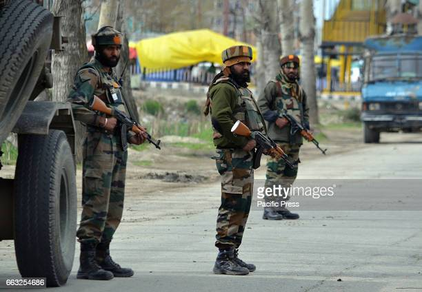 Indian army soldiers stand alert near the shootout site where suspected rebels attacked Indian army convoy in Bemina Srinagar the summer capital of...