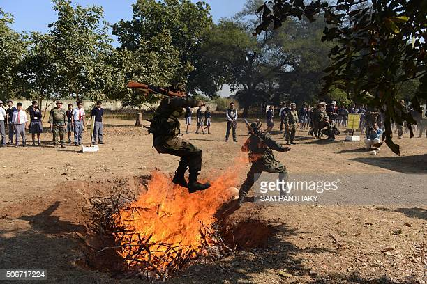 Indian Army soldiers take part in a demonstration on the eve of Indian Republic Day at the Golden Katar Division Parbat Ali Brigade Campus on the...