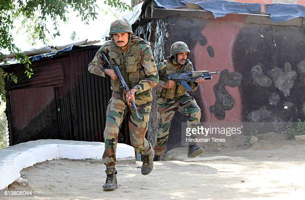Indian army soldiers take position near the Line of Control on October 10 2016 in Nowshera sector about 145 km from Jammu India