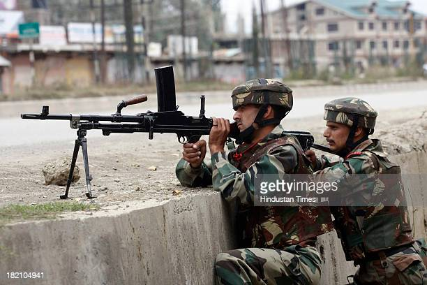 Indian Army soldiers take positions during an attack by militants between Sant Nagar and Hyderpora bypass road in the outskirts of Srinagar on...