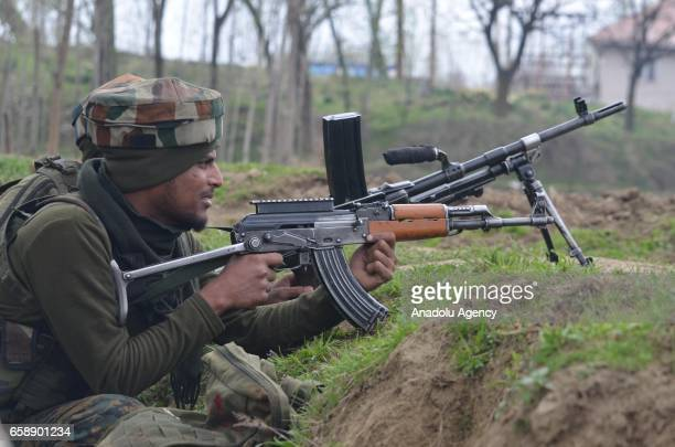 Indian army soldiers take positions near the encounter site in central Kashmirs Chadoora some 20 kilometers from Srinagar the summer capital of...