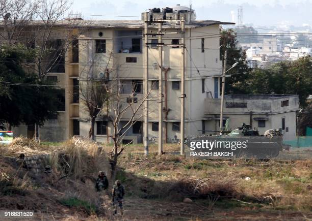 Indian Army soldiers take positions outside the residential quarters on the second day of a militant attack at Sunjwan Army camp in Jammu on February...