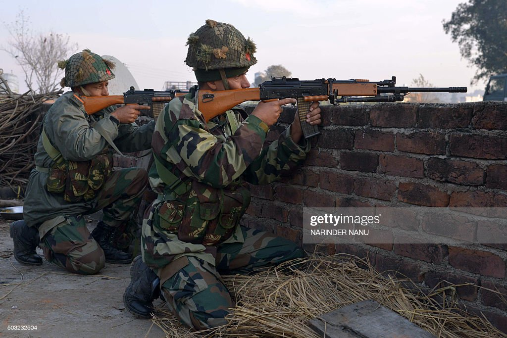Indian army soldiers take up position on the perimeter of an airforce base in Pathankot on January 3 during an operation to `sanitise` the base...