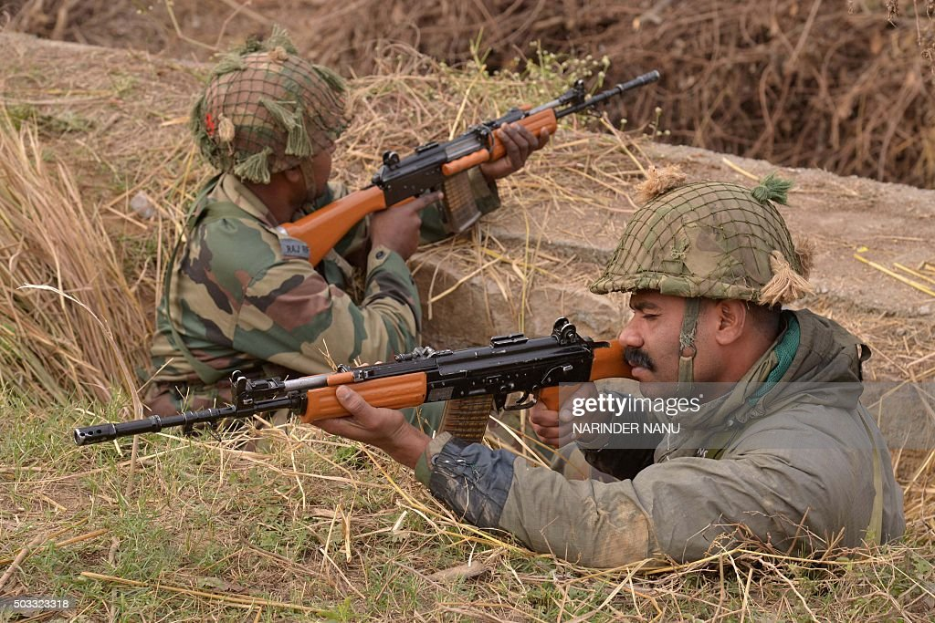 Indian army soldiers take up position on the perimeter of an airforce base in Pathankot on January 4 2016 Indian troops backed by helicopters...