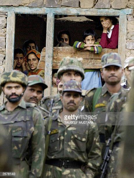 Indian Army soldiers watch the funeral of Mohammad Shafi Lone an Indian Army soldier in Uri 102 kms east of Srinagar 09 October 2003 as a group of...