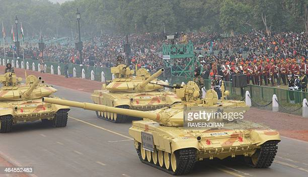 Indian Army T90 tanks roll down Rajpath during the final full dress rehearsal for the Indian Republic Day parade in New Delhi on January 23 2014...