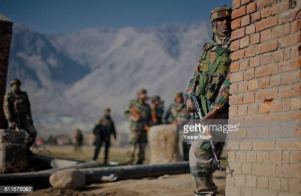 Indian army take soldiers take position near the gun battle site on February 21 2016 in Srinagar the summer capital of Indian administered Kashmir...