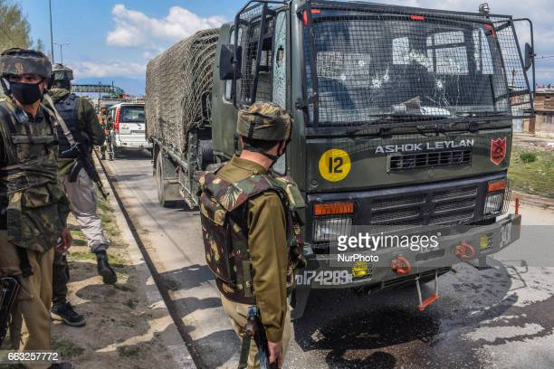 Indian army troopers examine their damaged vehicle after a militant attack on their convoy on April 01 2017 in Srinagar the summer capital of Indian...