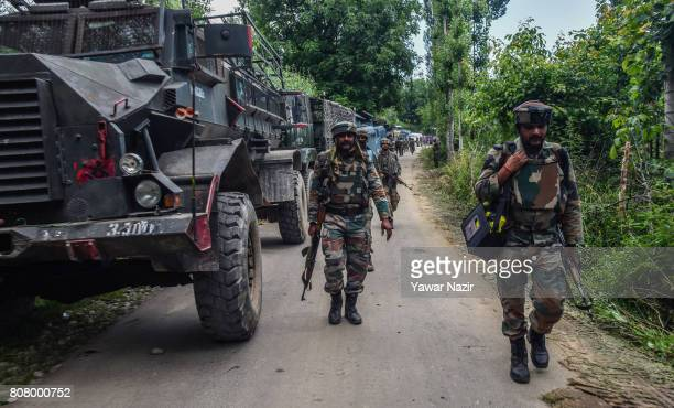 Indian army troopers leave the area after a gun battle between Indian government forces and rebels on July 4 2017 in Bahmnoo 60 km south of Srinagar...