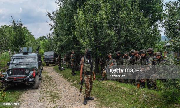 Indian army troopers stand guard in the area after a gun battle between Indian government forces and rebels on July 4 2017 in Bahmnoo 60 km south of...