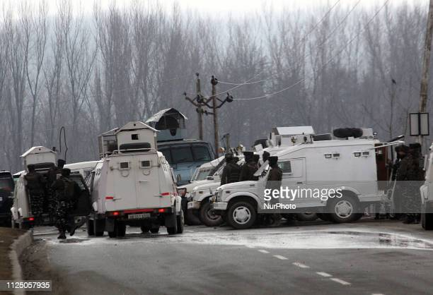 Indian army vehicles sarround the wreckage of a bus which was destroyed in Thursday's suicide attack in Lethpora area on the outskirts of...