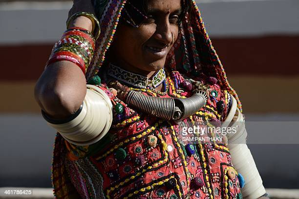 Indian artisan Sona wears traditional embroidered dress at Hodka village some 470 kms from Ahmedabad in the Kutch district of eastern Gujarat state...