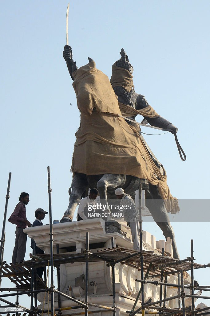Indian artisans work on a 45feet high statue of Maharaja Ranjit Singh a part of the government`s `83crore beautification project` along the most...