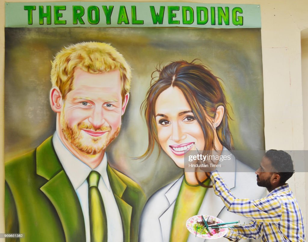 Indian artist Jagjot Singh Rubal gives final touch on a painting of Britain`s royal couple Prince Harry and Meghan Markle which he plans to send as a.