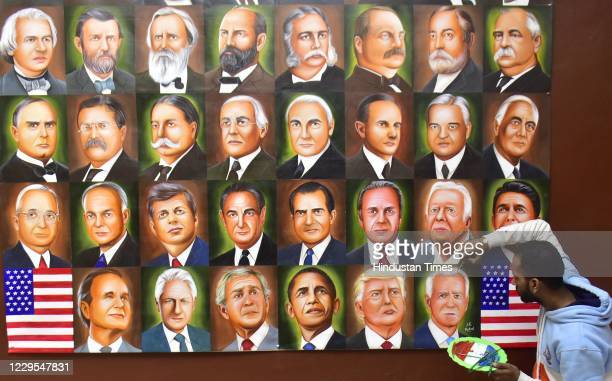 Indian artist Jagjot Singh Rubal gives final touches to a painting showing 46 US Presidents till date, to mark Joe Biden's victory in the US...