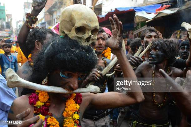 Indian artists dressed as an evil characters perform with human skull and bones during Maha ShivaRatri festivalcelebrated in reverence of the God...