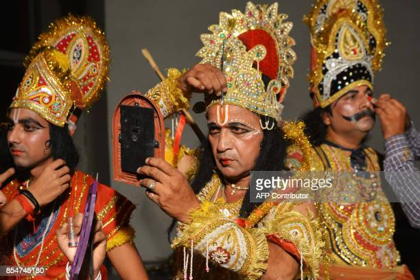 Indian artists dressed as Hindu Lord Rama Laxman and Ravan put on their makeup before performing the 'Ramleela' the story of Lord Rama ahead of the...