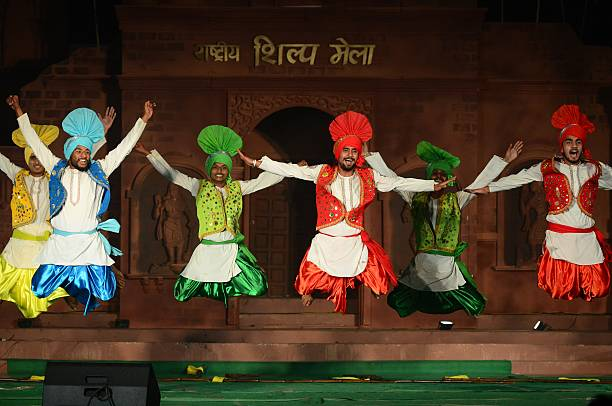 Indian artists from Punjab state perform during the Shilp Mela in Allahabad on December 8 2015 AFP PHOTO/ SANJAY KANOJIA / AFP / Sanjay Kanojia