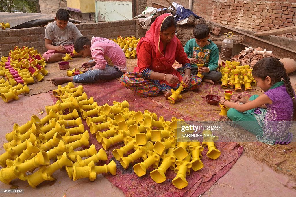 Indian artists paint clay `diyas` ahead of the Hindu festival of Diwali in Amritsar on November 6 2015 Diwali celebrated this year on November 11...