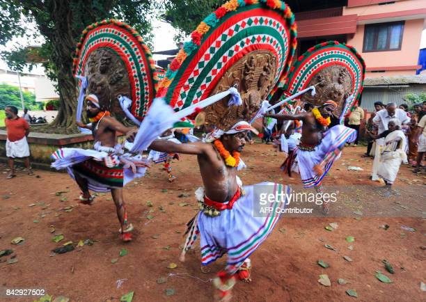 Indian artists perform the Kummatti mask dance during the Onam festival in the district of Thrissur in the state of Kerala on September 5 2017 / AFP...