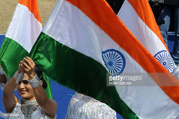 Indian artists wave the tricolour flag during a reunion of The Corps of Electronics and Mechanical Engineers at Polo Grounds in Secunderabad on...
