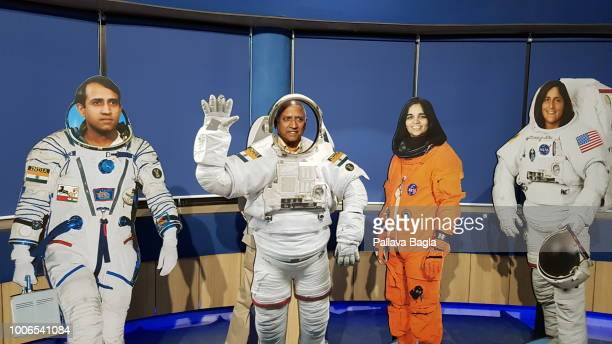 Indian astronaut Wing Commander Rakesh Sharma standing amidst cut outs including his 1984 persona in a current Indian space suit Astronaut Kalpana...