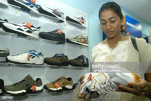 Indian athlete Anju George Bronze medalist of Long Jump in World Athletic Championship takes a closer look at professional sport footwears during the...