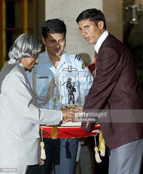 Indian athlete Devendra a gold medal winner at the 2004 Athens Paralympic Gamesreceives the prestigious Arjuna Award from Indian President APJ Abdul...