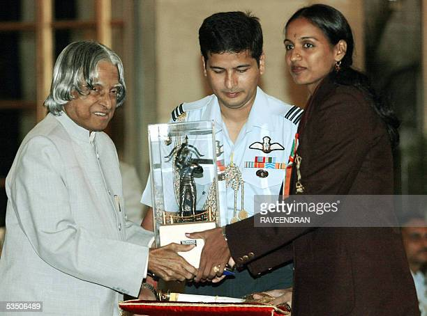 Indian athlete JJ Shobha receives the prestigious Arjuna Award from Indian President APJ Abdul Kalam at a sports and adventure awards function at the...