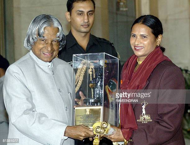 Indian Athlete Madhuri Saxena receives the prestigious Arjuna Award from Indian President APJ Abdul Kalam during an awards function at the...