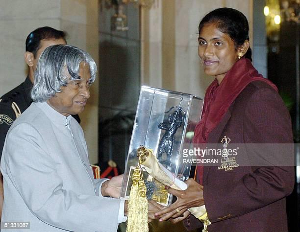 Indian Athlete Soma Biswas receives the prestigious Arjuna Award from Indian President APJ Abdul Kalam during an awards function at the Presidential...