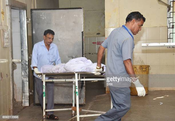 Indian attendants use a trolley to move the body of Irish tourist Danielle McLaughlin from the mortuary at Goa Medical College at Bambolim in Goa on...