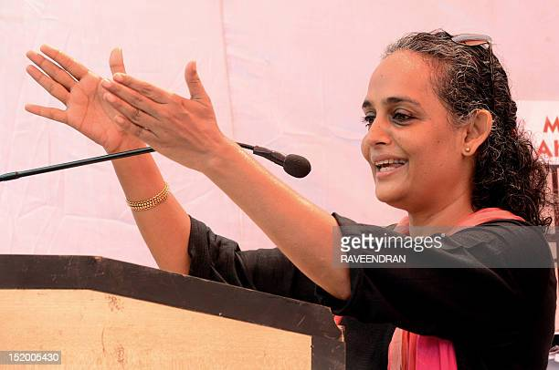 Indian author and poltical activist Arundhati Roy gestures as she addresses activists from The Popular Front of India a confederation of Muslim...