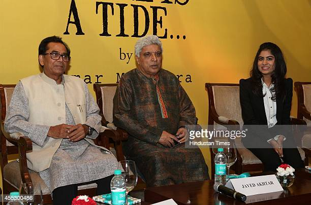 Indian author Ashok Chakradhar Bollywood lyricist Javed Akhtar and author Simar Malhotra during the launch of her novel There is a Tide at The Oberoi...